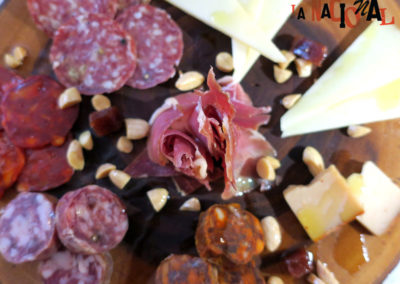 Selection of spanish cheeses and cured meats.