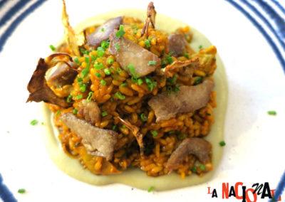 Rice with mushrooms and secreto ibérico in La Nacional Spanish Restaurant.